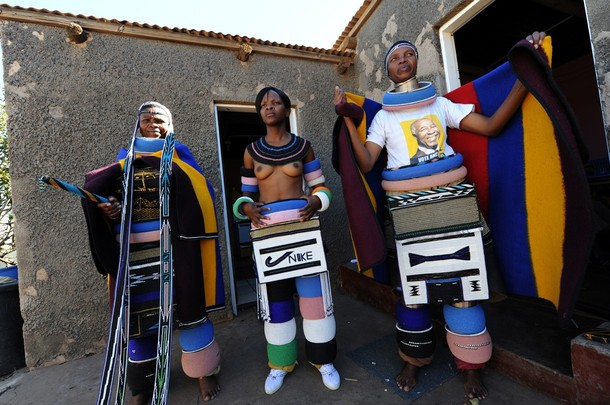 Members of the Ndebele tribe of South Africa display the traditional attire for married and single women in Kwaggafonten. PHOTO / Alexander Joe (Photo credit  ALEXANDER JOE/AFP/Getty Images)